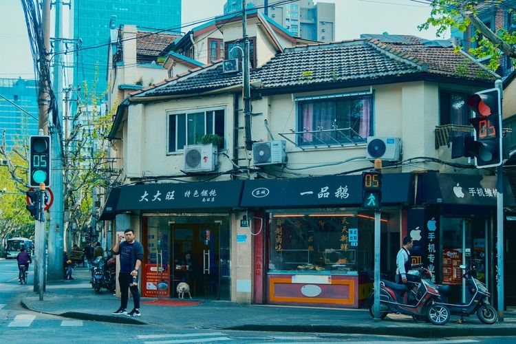 China Shanghai Building Exterior Architecture Built Structure City Street Transportation Men Mode Of Transportation People Window Building Road Women Store Land Vehicle Day Bicycle Text Real People Lifestyles