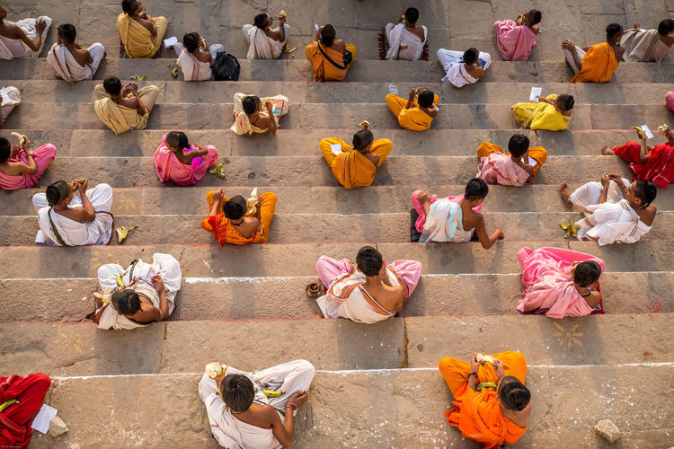 Group Of People Relaxation High Angle View From Above  Monk  Yoga School Yoga Pose Yoga Inspiration Colourful Dresses Colourful Clothing India Colourful India Colorful Colourful Brahmin Varanasi Varanasi, India Ganges, Indian Lifestyle And Culture, Bathing In The Ganges, Monk Students Young Monk Funny Hair Haircut Photography From Above