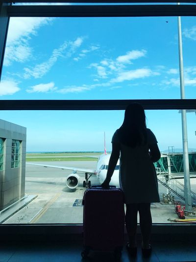 Airplane Airport Journey Travel Transportation Sky Rear View Day Real People Full Length Air Vehicle One Person Runway Nature Airport Runway Indoors  Passenger Boarding Bridge Airplane Wing Traveller Let's Go. Together.
