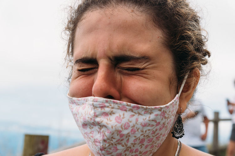 Close-up portrait of a girl wearing face mask