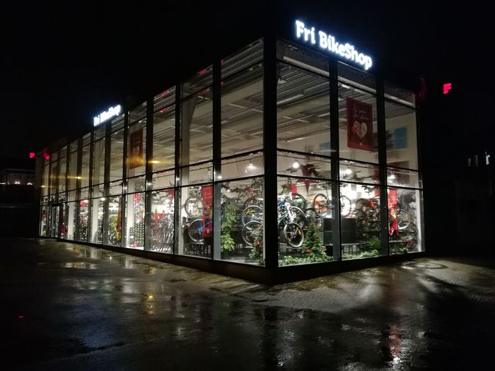 Night Reflection Illuminated Architecture No People Outdoors Bicycles Shop