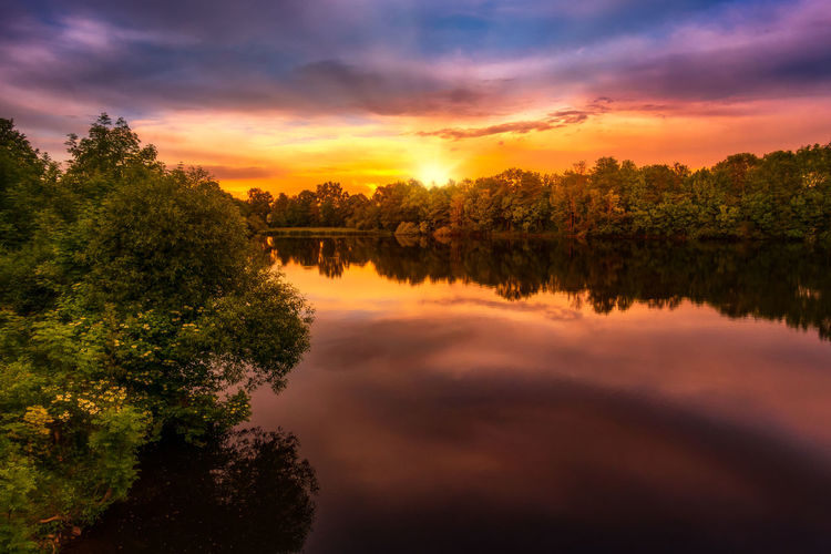 Beauty In Nature Cloud - Sky Growth Idyllic Lake Nature No People Non-urban Scene Orange Color Outdoors Plant Reflection Scenics - Nature Sky Sunset Tranquil Scene Tranquility Tree Water Waterfront