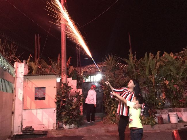 Navidad Night Real People Illuminated Standing Men Young Women Celebration Women Lifestyles Young Men Togetherness Arts Culture And Entertainment Building Exterior Outdoors Motion