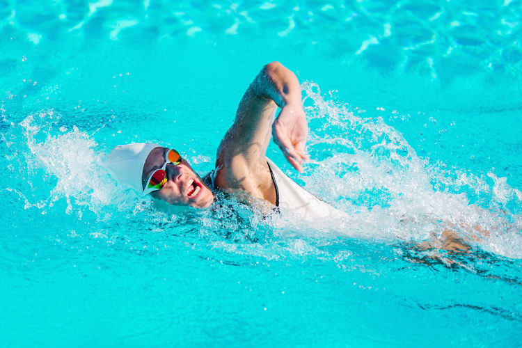 Female Swimmer on Training in the Swimming Pool Swimmer Female Water Sport Crawl Front Crawl Young Pool Competition Swimwear Athlete Goggles Training Swim Competitive Healthy People Active Cap Swimming Swimming Pool Energy Exercise Professional Woman Strength Adult Muscular Lifestyle Activity Race Action Winner Motion Health Skill  Caucasian White Exercising Healthy Lifestyle Sports Training Beautiful Outdoors Blue