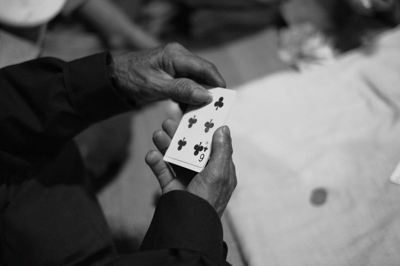 Human Hand Real People Holding Leisure Games Human Body Part Playing Focus On Foreground Gambling Leisure Activity Indoors  One Person Chance Close-up Skill  Day People