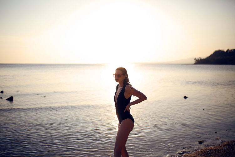 After swim Water Sea Sky Lifestyles Sunset One Person Land Beach Leisure Activity Horizon Over Water Beauty In Nature Horizon Scenics - Nature Young Adult Real People Swimwear Holiday Trip Woman Bathing Suit  One Piece Backlight Golden Hour Girl Beautiful
