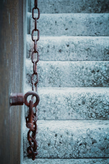 Chain hanging on steps