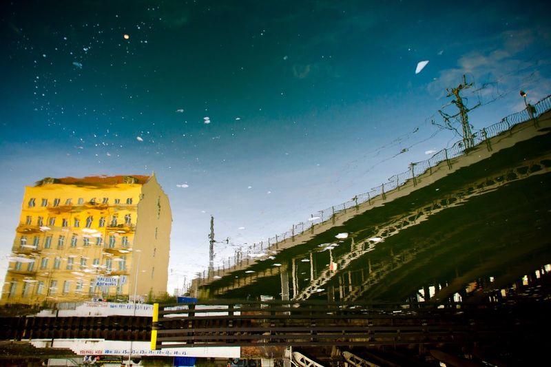 High angle view of bridge reflecting on river
