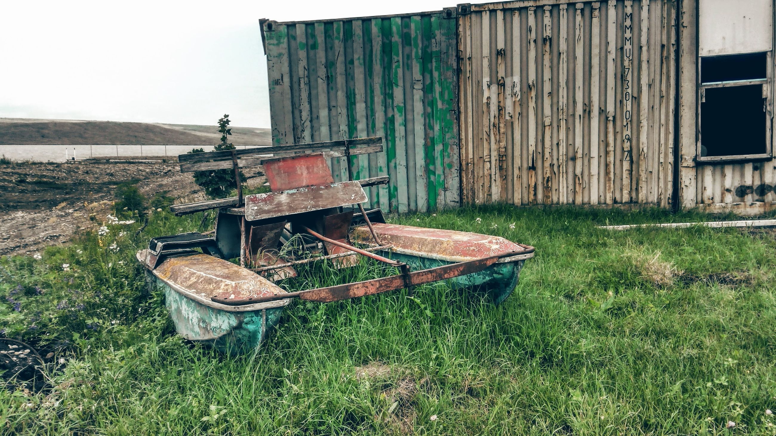 building exterior, built structure, architecture, grass, abandoned, house, damaged, obsolete, old, water, plant, run-down, deterioration, day, residential structure, outdoors, no people, field, bad condition, grassy