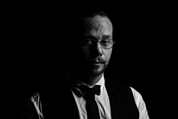 Testing a selfportrait One Person Portrait Headshot Front View Black Background Indoors  Males  Male Adult Men Studio Shot Well-dressed Serious Formalwear Necktie Menswear Looking At Camera Buisness Contemplation Dark Young Adult Young Men Self Portrait Selfportrait