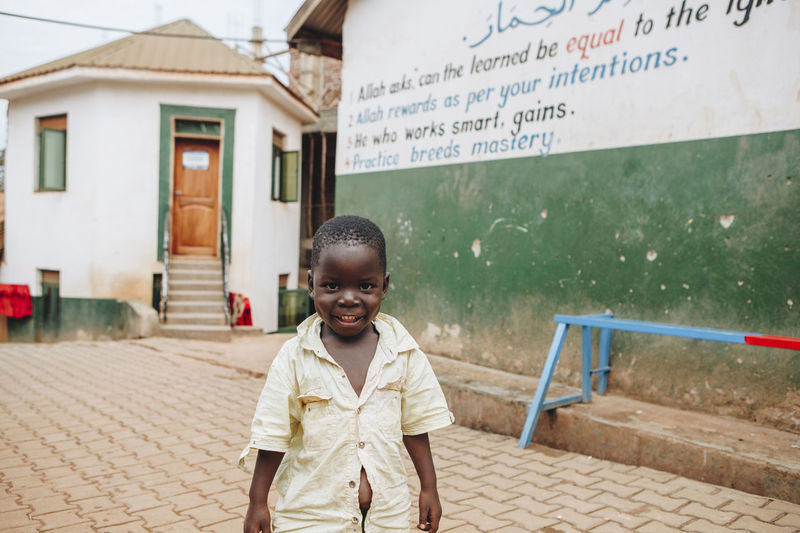 Africa African Boy Building Exterior Cheerful Child Childhood Children Only Cultures Looking At Camera Motivation Muslim One Person Outdoors Portrait Potential  Proverbs Quotes Real People School Smiling Student Teaching Writing Writing On The Walls