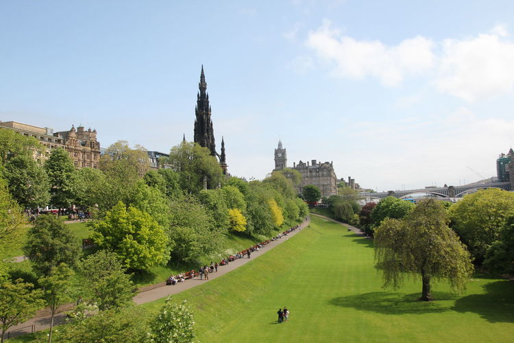 Princes Street Gardens Architecture Beauty In Nature Building Exterior Built Structure Church Cloud - Sky Day Green Green Color Growth Nature Outdoors Person Place Of Worship Princes Street Gardens Scenics Scott Monument Sky Tourism Tranquil Scene Tranquility Tree