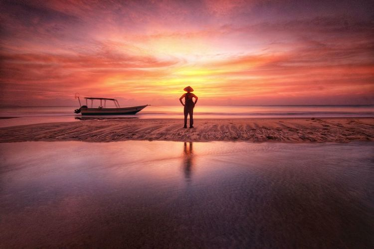 A fisherman looking the boat in the golden sunrise Seascape One Man Only Sunrise Morning Shillouettes And Sunshine Morning Sky Water Nautical Vessel Sea Low Tide Beauty Beach Wave Fisherman Romantic Sky Fishing Boat Dramatic Sky Seascape
