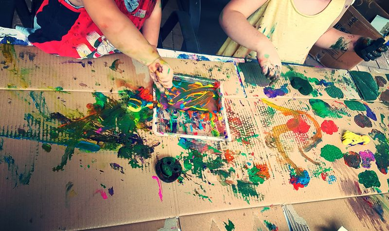 Artsandcrafts Kids Being Kids Human Hand Leisure Activity Artist Skill  Art And Craft Togetherness Two People Real People Lifestyles Paint Indoors  Multi Colored Sticky Creating Messy Life
