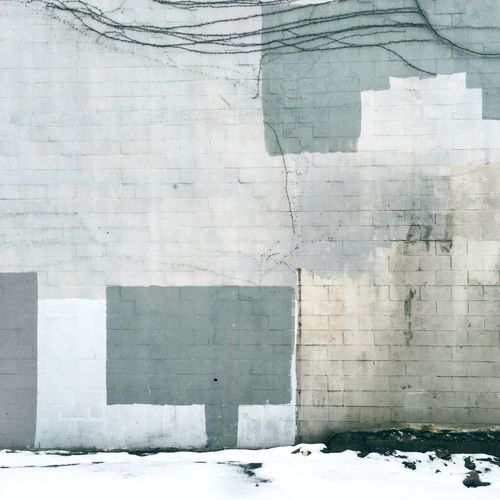 Patchwork on wall during winter