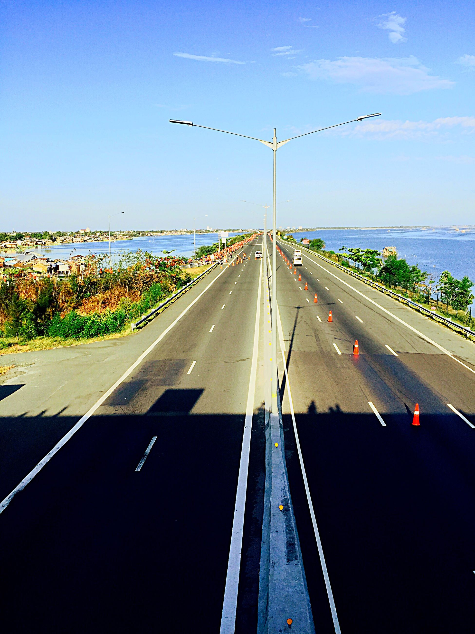transportation, road marking, mode of transport, road, car, land vehicle, the way forward, on the move, highway, diminishing perspective, travel, windshield, sky, vanishing point, clear sky, street, journey, high angle view, dividing line, traffic
