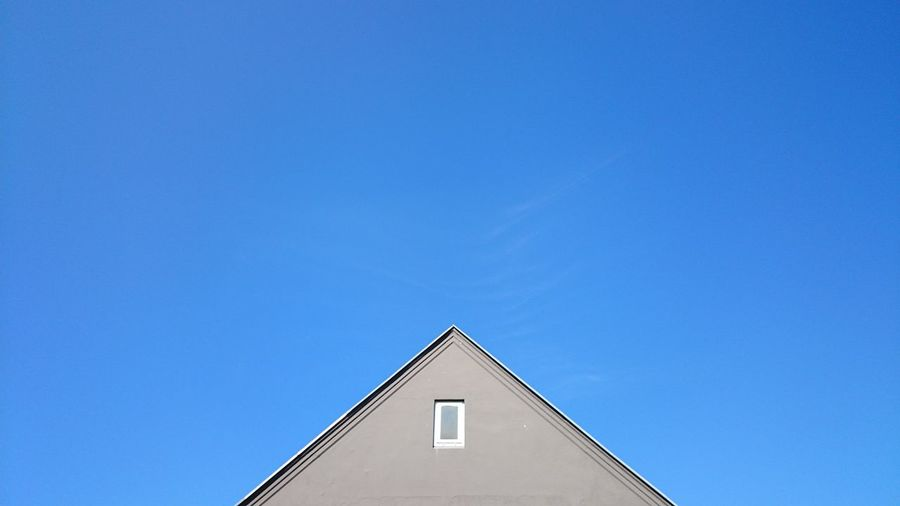 High section of house against clear blue sky
