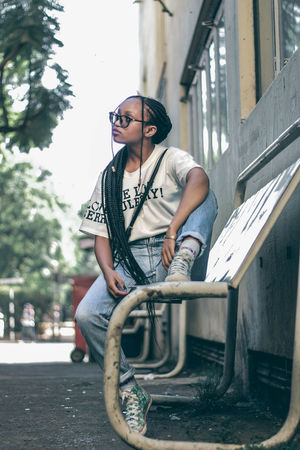 Street fashion EyeEm EyeEm Best Shots Fresh On Market 2018 Streetphotography Teenager Street Portrait Africa Woman Young Adult One Person Casual Clothing One Young Woman Only Young Women One Woman Only Fashion Sitting Arts Culture And Entertainment Leisure Activity Cool Attitude Front View