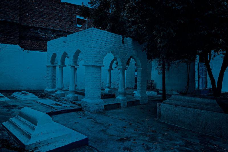 View of cemetery against buildings