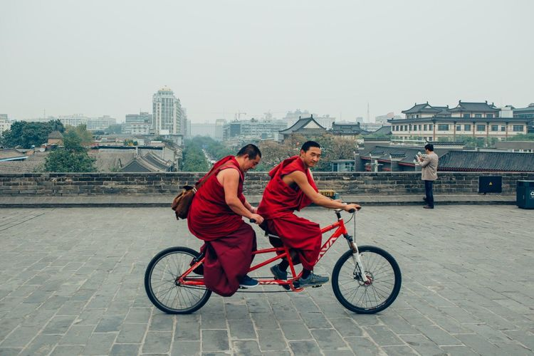 TakeoverContrast Bike Tandem Cycle Cycling Monk  Red Happy Happiness China Xian City Life The Week Of Eyeem EyeEm Best Shots Eye4photography  Cityscape This Week On Eyeem Travel Vscocam VSCO Travel Photography Travel Destinations Buddhism Redstartravel
