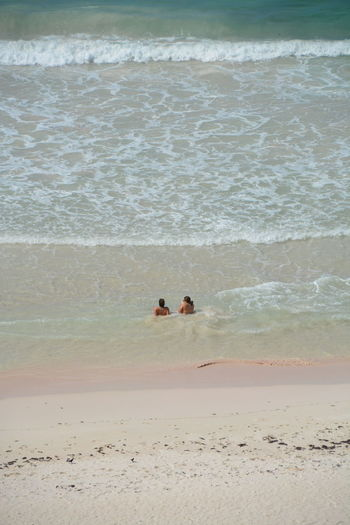 Relaxing Adult Beach Beauty In Nature Day Land Leisure Activity Nature Outdoors People Real People Sand Sea Sitting In Water On Beach Two Girls On The Beach Two People Water Wave