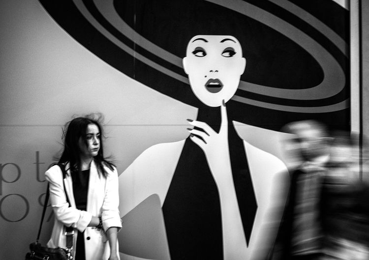What If... Indoors  Leisure Activity Standing Front View Lifestyles Human Representation Blackandwhite Black And White Streetphotography Streetphoto_bw EyeEm Best Shots Casual Clothing Young Women Person Holding Looking At Camera In Front Of Focus On Foreground Confidence