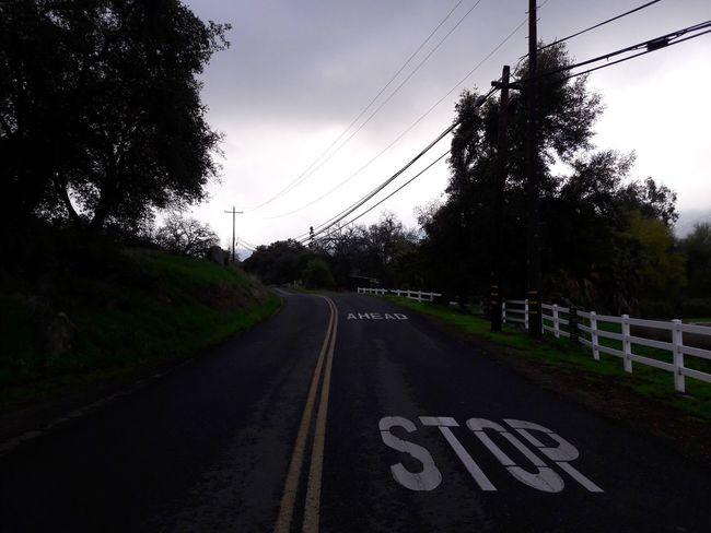 Road Signs Stop Ahead Overcast Rainy Days Morning Rain Curvy Road Outdooradventure Outdoors Uphill