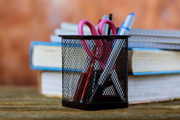 Group of school supplies and books over a wood background Back To School Book Education Equipment Notebook Paper Pencil Pencil Drawing School School Supplies Supplies Supplies Office Tools