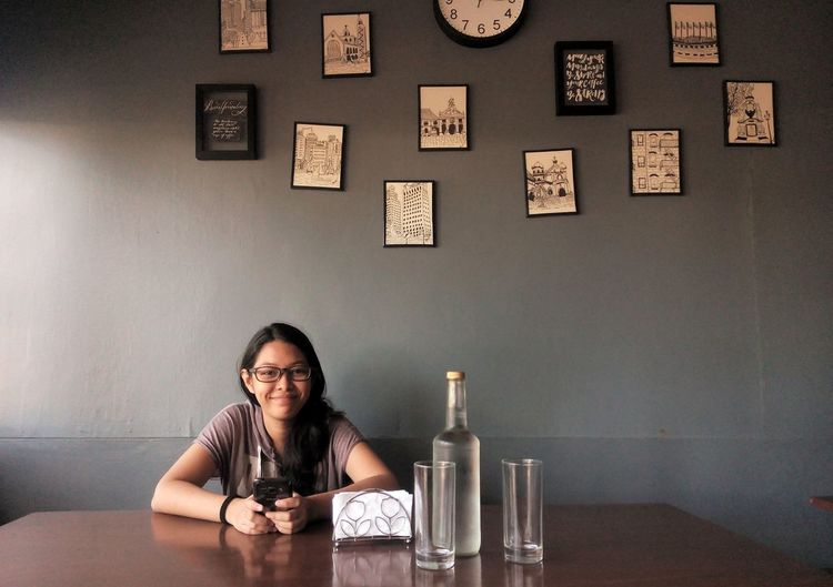 EyeEm Selects One Person Only Women Table Indoors  People Sitting Portrait Food And Drink Looking At Camera Smiling Happy Hour Cafe Front View Women Huaweigr52017 Philippines EyeEm Gallery Eyeem Philippines PhonePhotography EyeEm Best Shots One Young Woman Only Young Women Adult Young Adult