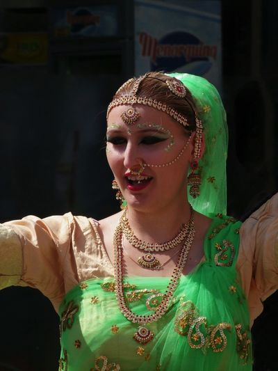 Head & Shoulders of Indian Dancer Beautiful Woman Budapest Capital City Celebration Close-up Composition Dancer Dancing Front View Full Frame Green Colour Happiness Head And Shoulders Hungary Indian Costume Indian Festival Looking At Camera No Incidental People One Person Outdoor Photography Singing Smiling Standing Sunlight And Shade Young Woman