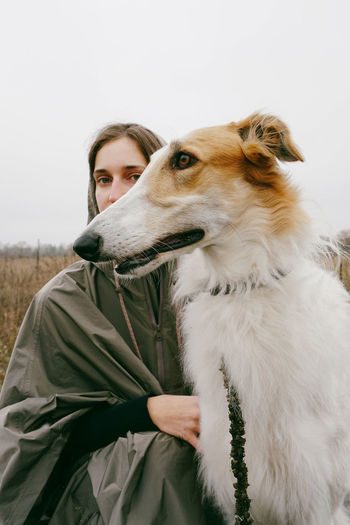 One Animal Domestic Animals Canine Dog Mammal Portrait Lifestyles Young Adult Looking At Camera Pet Owner Leisure Activity Pets One Person Domestic Real People Autumn Fall Doggo Borzoi Portrait Of A Woman Animal Themes Hunter Hunting Dog Serious Focused