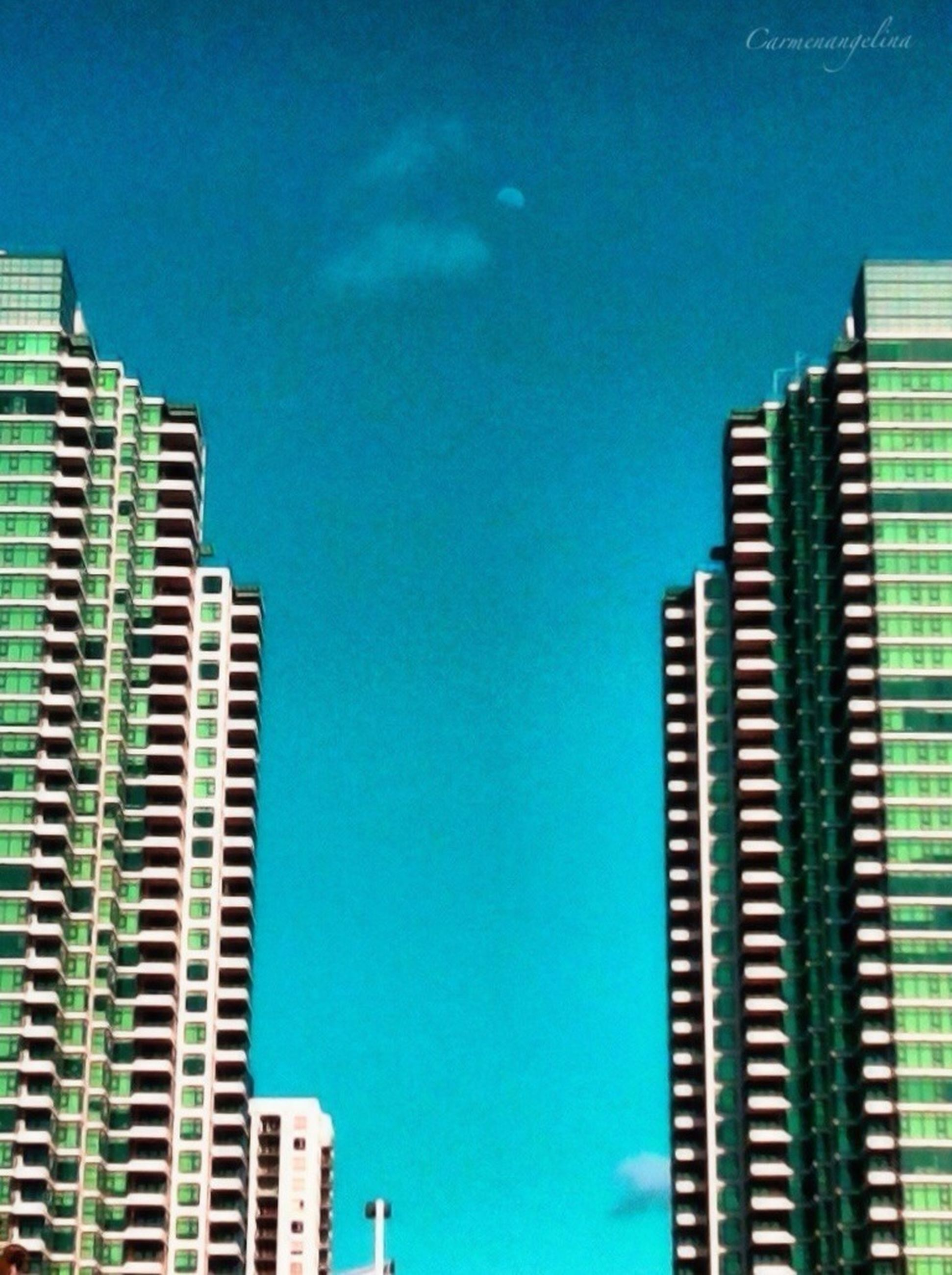 building exterior, blue, architecture, built structure, city, low angle view, clear sky, building, skyscraper, modern, office building, copy space, tall - high, sky, residential building, residential structure, outdoors, no people, day, city life