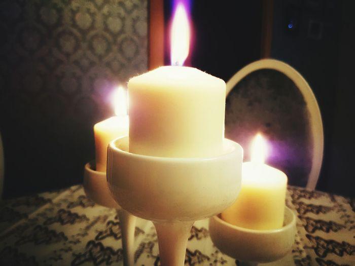 Flame Candle Burning Fire - Natural Phenomenon Candlelight Illuminated Heat - Temperature Glowing Yellow Close-up Indoors  No People Luminosity Tea Light Birthday Candles Day Navidad 2016 Navidad!