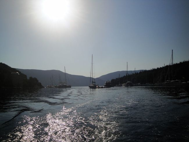 Grecia Water Sky Nautical Vessel Mountain Sun Beauty In Nature Sunlight Nature Transportation Sailboat Scenics - Nature Mode Of Transportation No People Clear Sky Day Sea Tranquil Scene Tranquility Mountain Range Lens Flare Femalephotographerofthemonth 43GoldenMoments Popular Photos Taking Photos