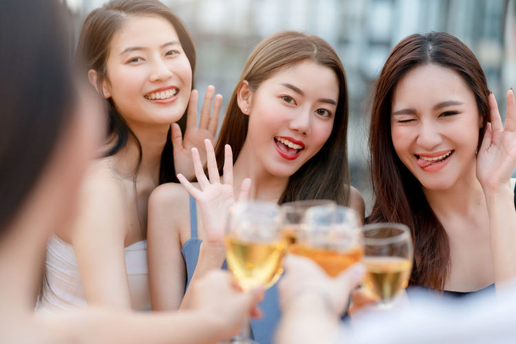 Friends enjoying wine at party