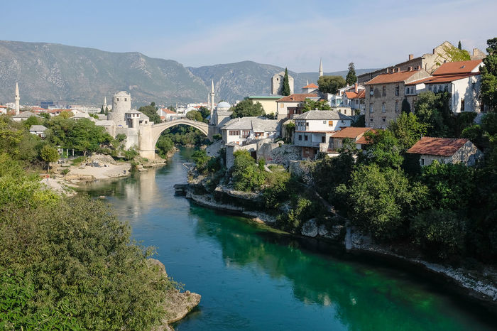 View of Mostar town overlooking river Mostar Mostar Bridge Architecture Bridge - Man Made Structure Built Structure Day High Angle View House Mountain Nature Nautical Vessel Outdoors River Stari Most Tara River Town Transportation Water Waterfront
