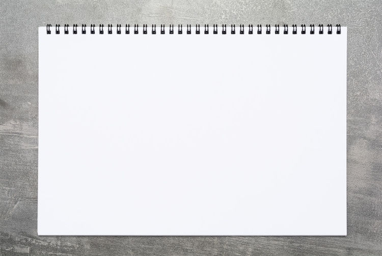 Blank page of a sketchbook on a gray surface Creativity Planning Sketch Write Backgrounds Blank Cement Close-up Concrete Copy Space Empty Gray Grunge Ideas Inspiration Message Note Note Pad Notebook Page Paper Sketchbook Spiral Table White Color