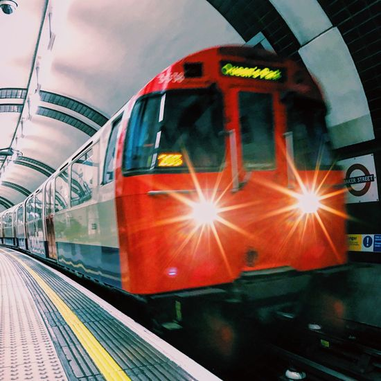 At the speed of light 🚇| instagram: @mauronewyork | Transportation Mode Of Transport Public Transportation Rail Transportation Travel Passenger Train Train - Vehicle Railroad Station Land Vehicle Railroad Station Platform No People Subway Train Metro Train Outdoors Sky Day Traveling London London Lifestyle Underground Red