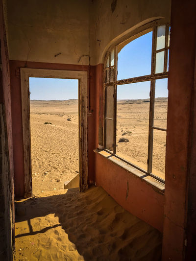 Ghost Town Kolmanskuppe in Lüderitz, Namibia Abandoned Architecture Bad Condition Building Exterior Built Structure Damaged Day Destruction Deterioration House Indoors  Messy No People Obsolete Old Old Ruin Peeling Off Ruined Run-down Rural Scene Sky Sunlight Sunny Weathered Window