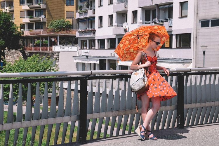 Architecture Austria Building Built Structure Casual Clothing City City Life Day Full Length Leisure Activity Lifestyles Outdoors Regenschirm Season  Umbrella Villach