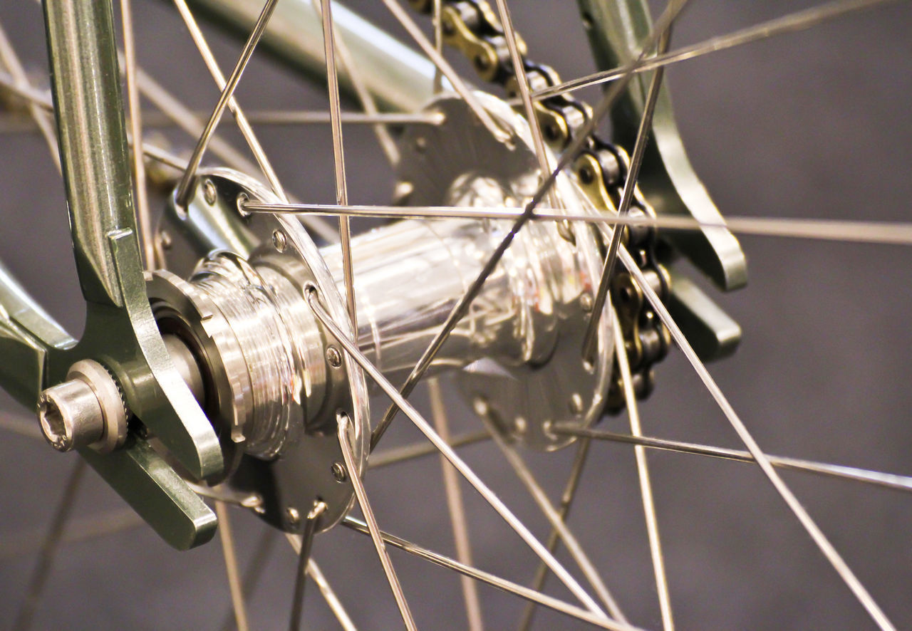 MACRO SHOT OF BICYCLE WHEEL WITH CHAIN
