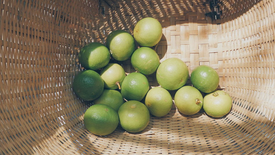 Group of limes in wooden basket Fruit Healthy Eating Food And Drink Green Color Food Indoors  Freshness No People Lime Vegetable Group Sour Juicy Wooden Basket Container Nature Natural