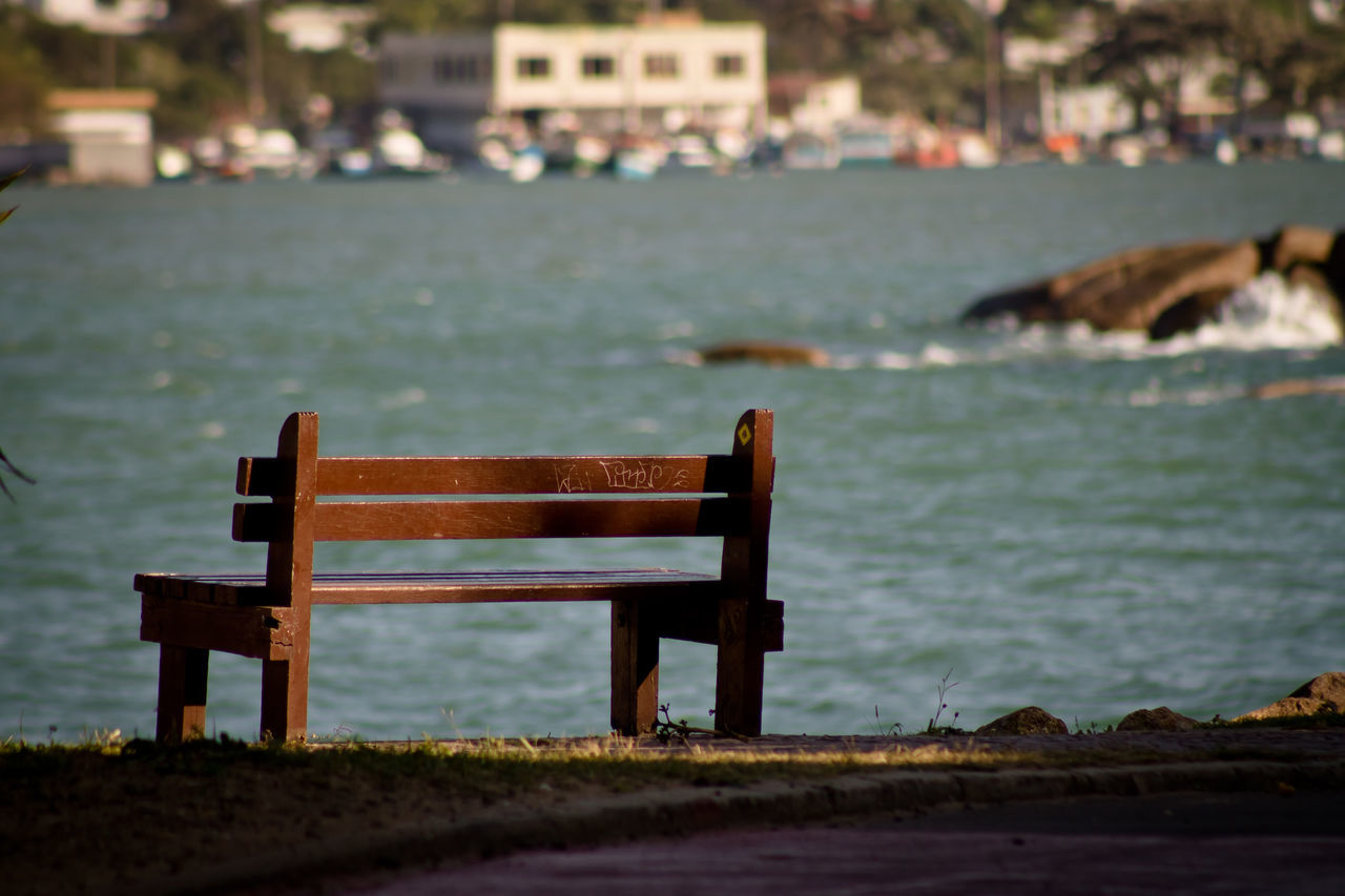 Empty Wooden Bench By Lake