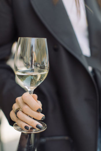 One Person Hand Holding Human Hand Wine Glass Midsection Food And Drink Human Body Part Alcohol Refreshment Focus On Foreground Wineglass Drink Real People Lifestyles Day Transparent Finger Fashion Luxury Jacket Black Manicure