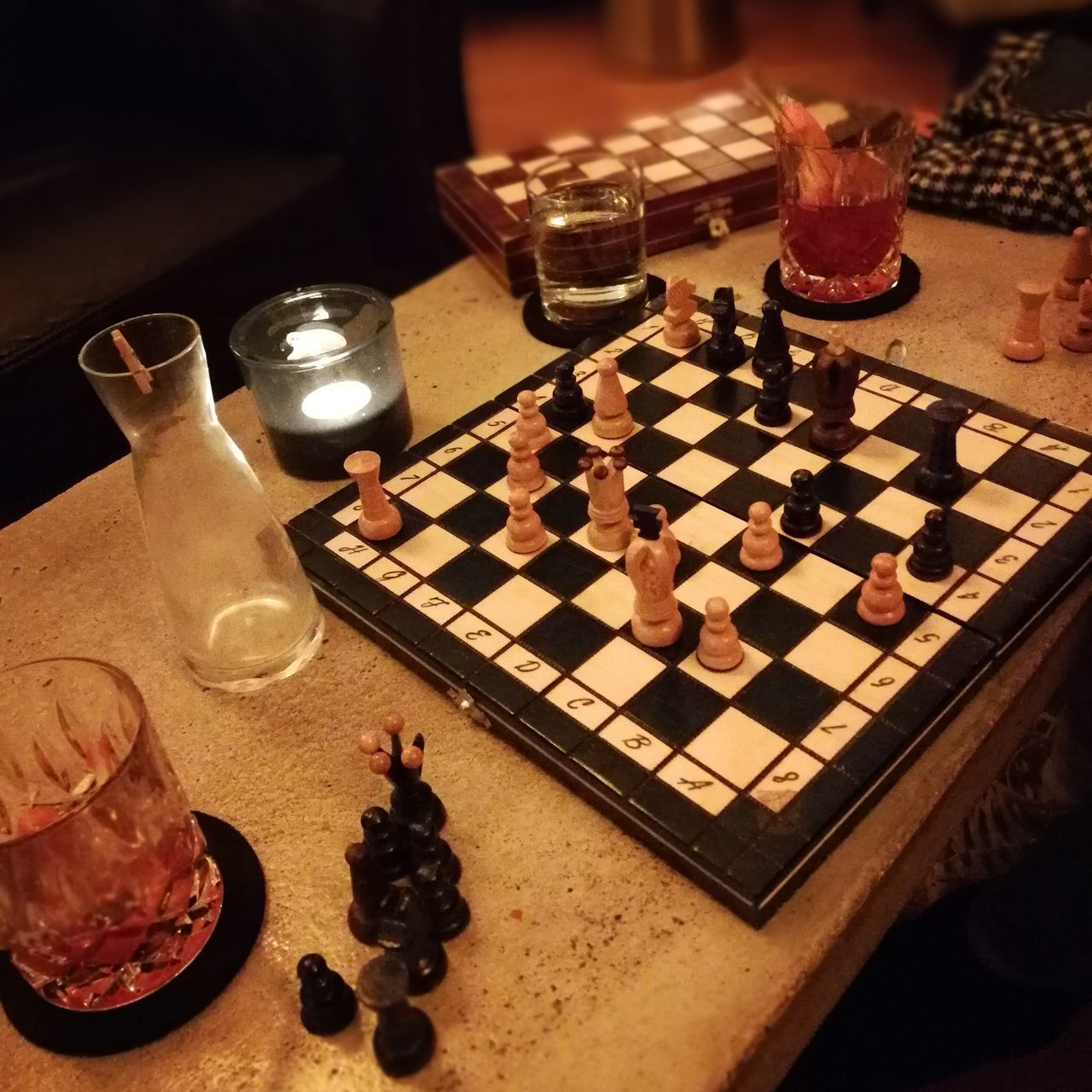 HIGH ANGLE VIEW OF CHESS PIECES ON TABLE AT HOME