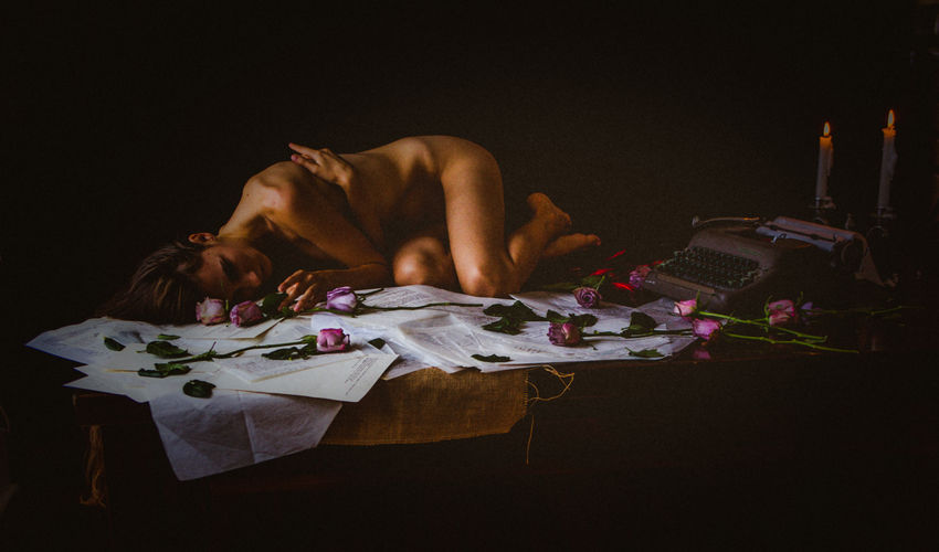 The Creative - 2018 EyeEm Awards Candle Depression - Sadness Emotion Full Length Lying Down Night One Person Poetry Shirtless Social Issues Studio Shot Table Women
