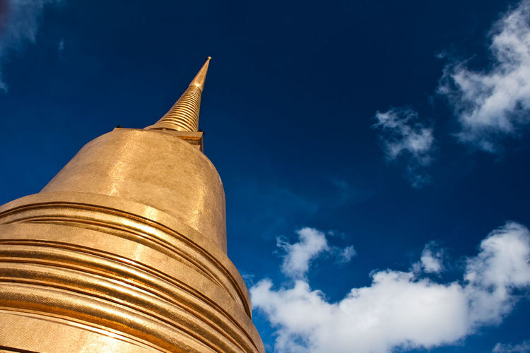 Low angle view of stupa against sky