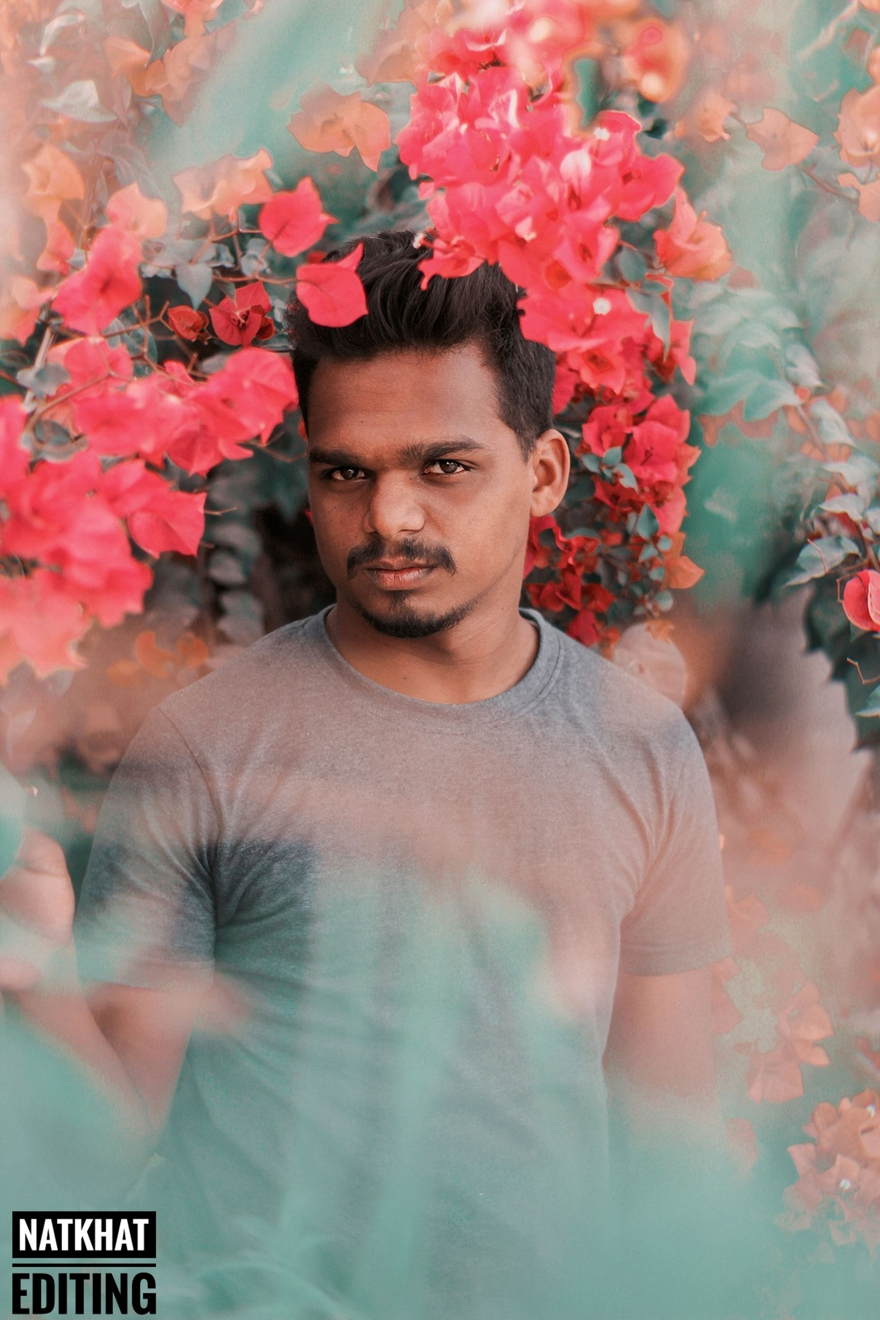 young men, one person, young adult, flower, plant, flowering plant, front view, portrait, lifestyles, real people, casual clothing, looking at camera, leisure activity, standing, waist up, nature, growth, focus on foreground, outdoors, contemplation