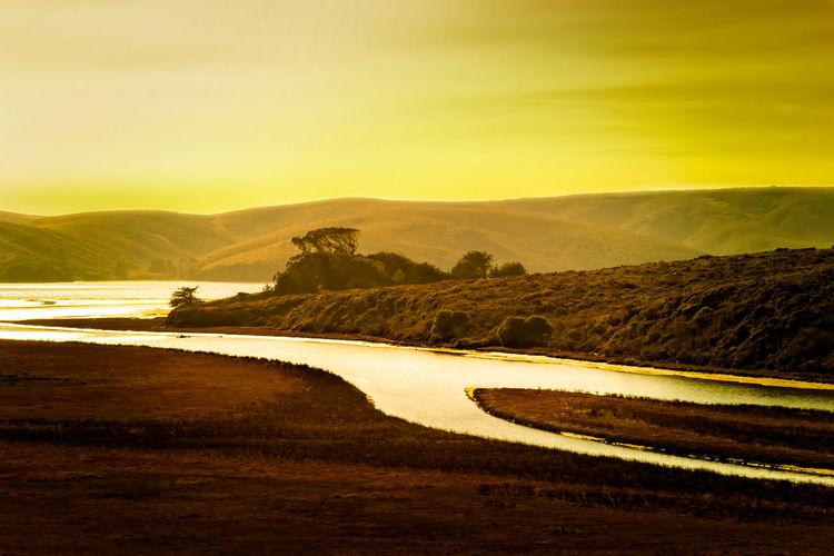 Stream of gold, sunset landscape in california usa