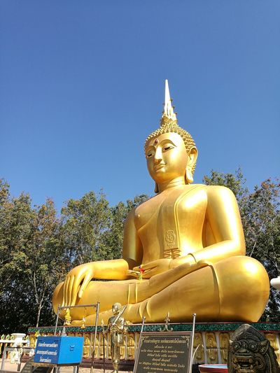 Religion Human Representation Statue Gold Colored Sitting Place Of Worship Spirituality Gold Cultures Low Angle View Sculpture Idol No People Day Outdoors Sky